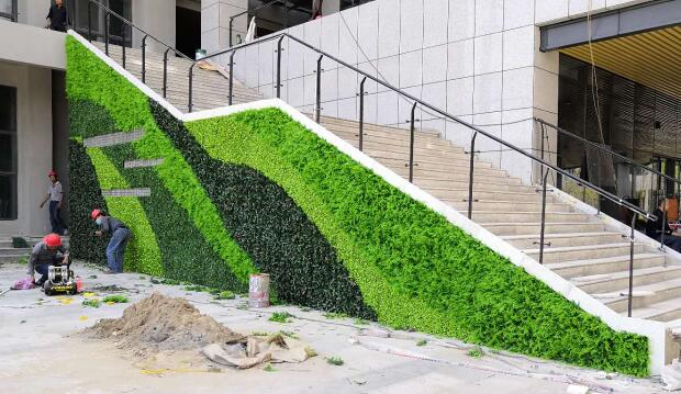 Artificial wall covering plants to beautify business